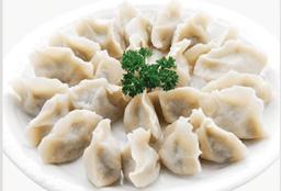 Dumplings Cocidos de Chancho y Camarones